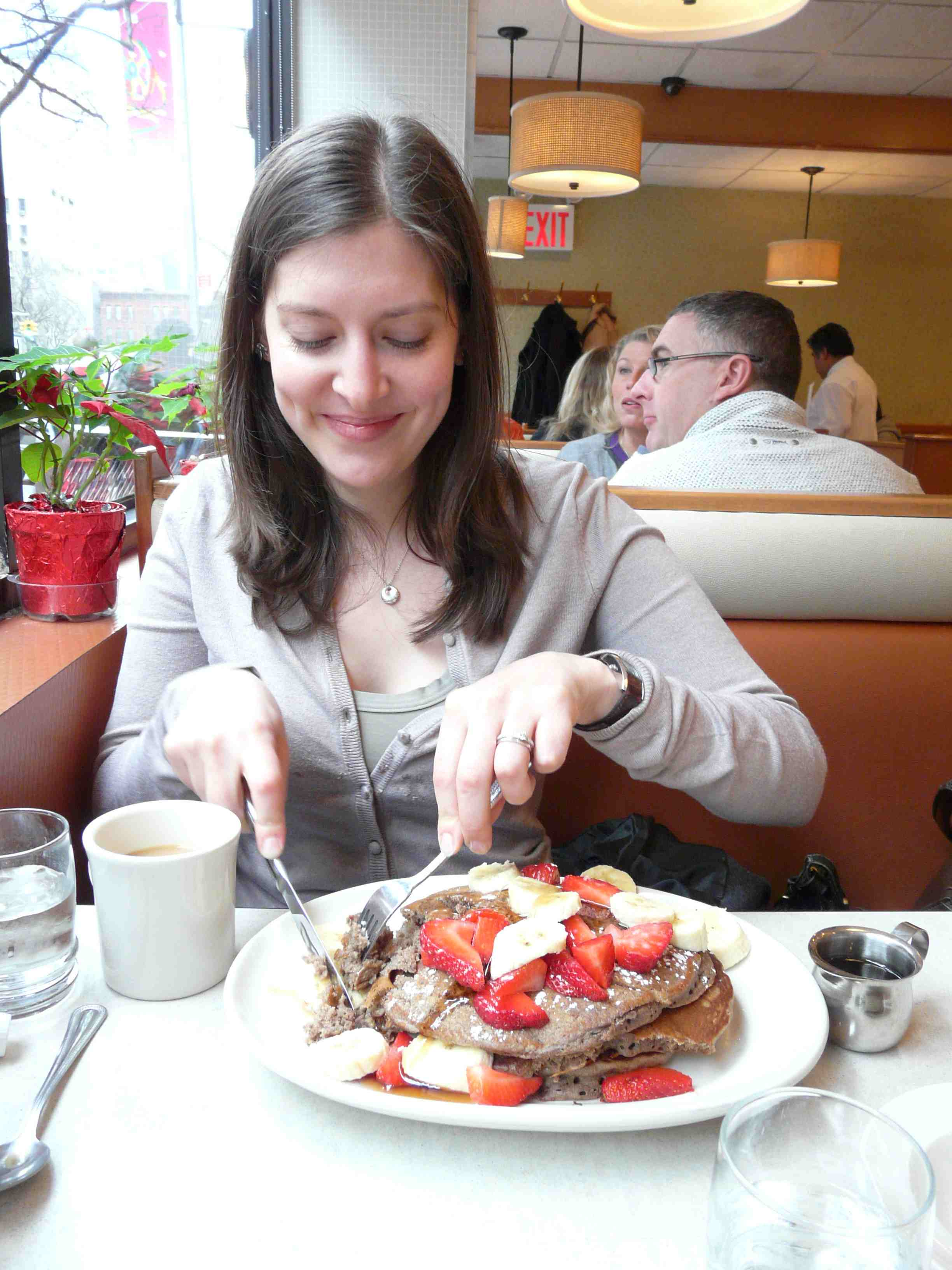 claire-eating-huge-pile-on-pancakes.jpg